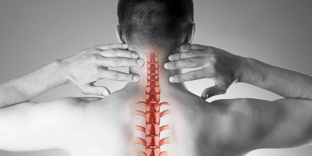 What is NUCCA chiropractic. A man points to where NUCCA chiropractors focus their adjustments.